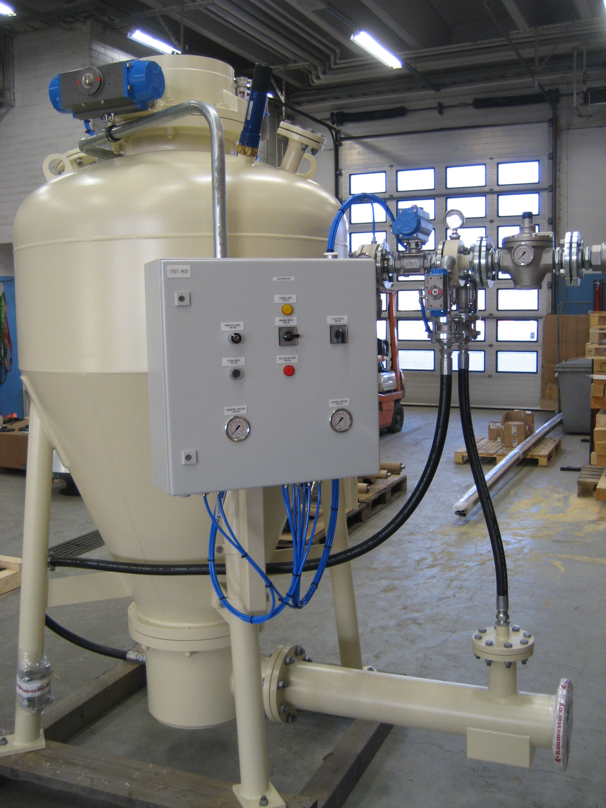 Ash handling systems for industrial biomass boilers