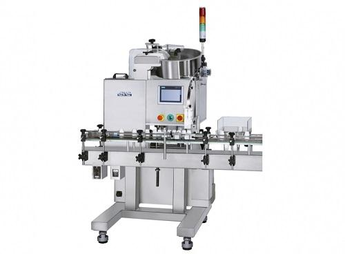 Dessicant inserting machine
